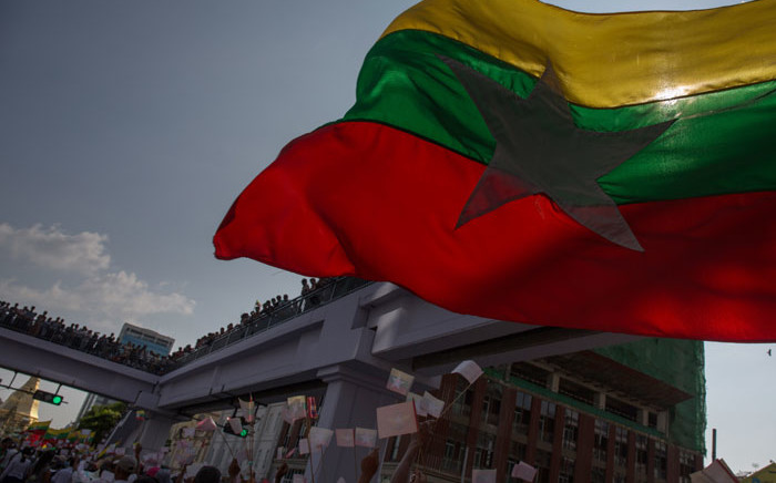The Myanmar flag flies during a march in Yangon. Picture: AFP