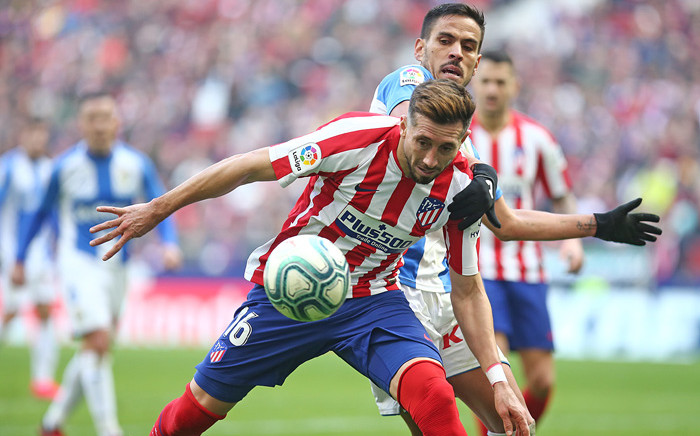 Leganes' Spanish midfielder Recio (R) challenges Atletico Madrid's Mexican midfielder Hector Herrera during the Spanish league football match Club Atletico de Madrid against Club Deportivo Leganes SAD at the Wanda Metropolitano stadium in Madrid on 26 January 2020. Picture: @atletienglish/Twitter