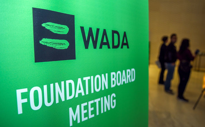 Journalists stands in the lobby of the World Anti-Doping Agency (WADA) foundation board in Baku on 15 November 2018. Picture: AFP.