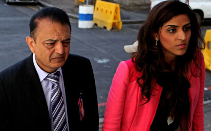 Anni Dewani's father Vinod Hindocha is seen with a relative outside the Western Cape High Court on Monday, 27 August 2012 at the trial of Dewani's alleged killer. Picture: Sapa.