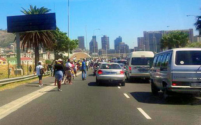Protesters making their way towards Strand Street in Cape Town. Picture: via Twitter @Liezelv
