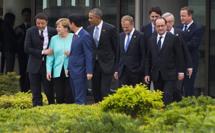 (From left) Italian Prime Minister Matteo Renzi, German Chancellor Angela Merkel, Japanese Prime Minister Shinzo Abe, US President Barack Obama, European Council President Donald Tusk, Canadian Prime Minister Justin Trudeau, French President Francois Hollande, European Commission President Jean-Claude Juncker and British Prime Minister David Cameron walk out to the family photo event during the first day of the Group of Seven (G7) summit meetings in Ise city on May 26, 2016. Picture: AFP.