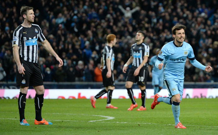 Manchester Citys Spanish midfielder David Silva (R) celebrates after scoring his teams fifth goal during the English Premier League football match between Manchester City and Newcastle at the The Etihad Stadium in Manchester, north west England on 21 February, 2015. Picture: AFP