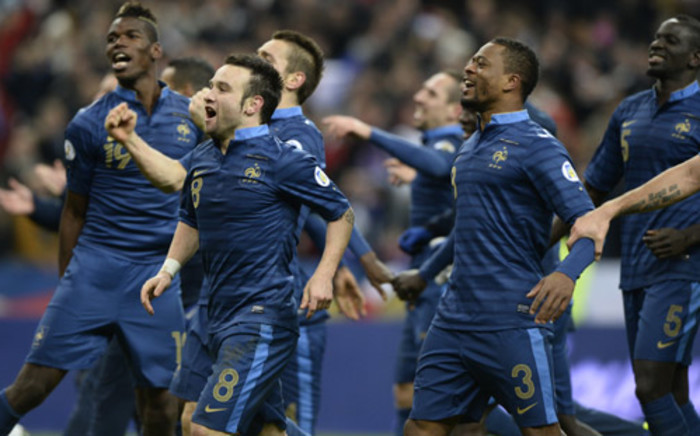 French players celebrate at the end of the FIFA World Cup 2014 qualifying football match against Ukraine,on 19 November 2013 at the Stade de France in Saint-Denis, outside Paris. Picture: AFP