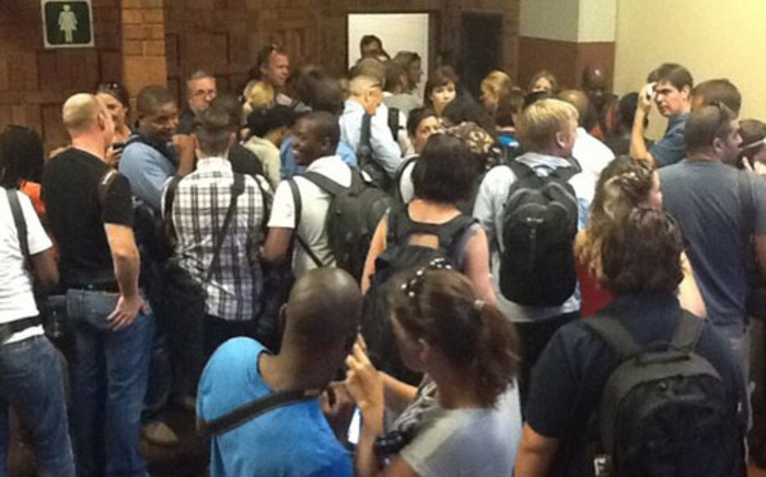 Crowds of journalists gather outside the courtroom where Oscar Pistorius is scheduled to appear on a murder charge on 19 February 2013. Picture: Mandy Wiener/EWN.