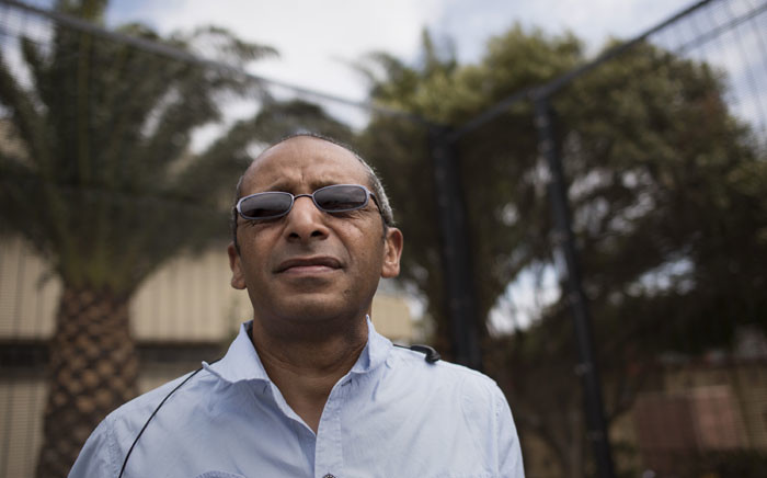 In this photograph taken in Cape Town on 22 January 2020, Cassiem Morris, a former resident of District 6, stands in front of the Cape Peninsula University of Technology, where his families' house was, in the colourful suburb of District 6 was before it was destroyed by the Apartheid government. Picture: AFP