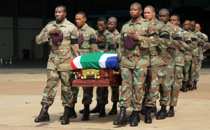 SA soldiers carry the bodies of their deceased colleagues. Picture: EWN