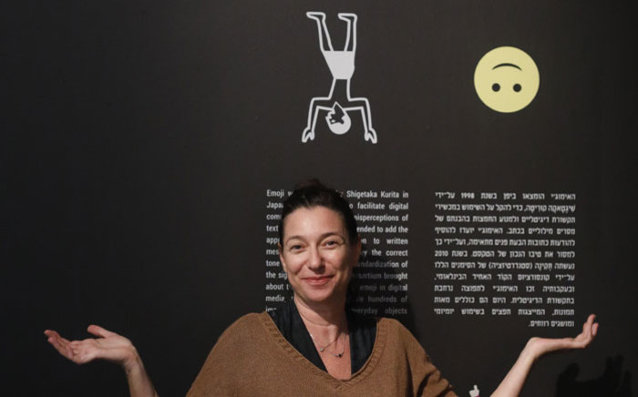 Curator Shirly Ben-Dor Evian poses for a picture as she presents the exhibition 'Emoglyphs: Picture-Writing from Hieroglyphs to the Emoji', at the Israel Museum in Jerusalem, on 19 December 2019. Picture: AFP