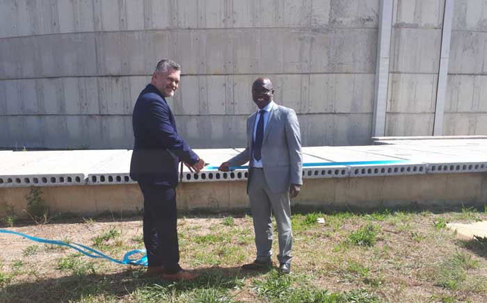 MMC for Environment and Infrastructure Services Nico de Jager (left) officially opens a reservoir to supply water to the residents of Diepsloot. Picture: @JHBWater/Twitter.