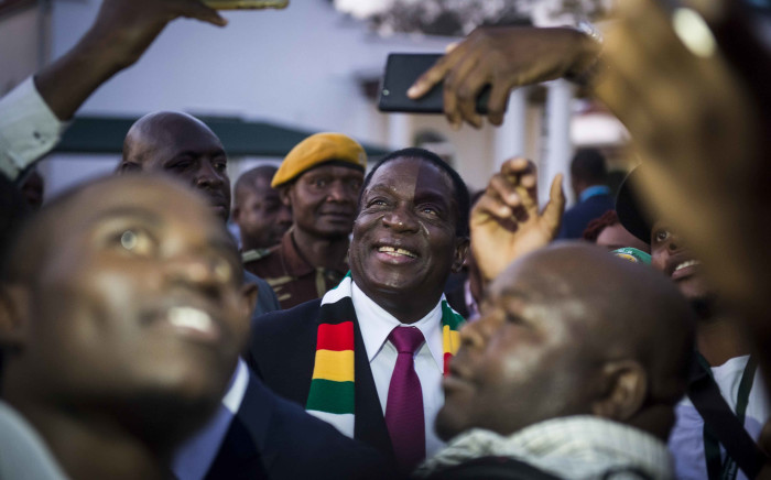President-elect ED Mnangagwa takes selfies with members of the press at State House, Harare. Picture: Thomas Holder/EWN.