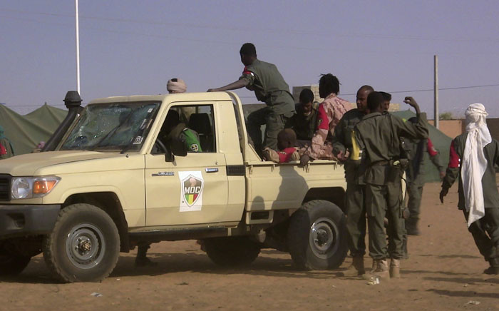 FILE: Soldiers gather at a pickup truck following a suicide bomb attack in Mali. Picture: AFP.