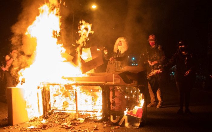Protesters set a sofa on fire in West Philadelphia on October 27, 2020, during a demonstration against the fatal shooting of 27-year-old Walter Wallace, a Black man, by police. Picture: AFP.