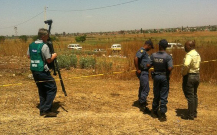 Police on the scene where two bodies of young girls were found in Katlehong, east of Johannesburg. Picture: Reinart Toerien/EWN