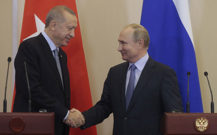 Turkey President Recep Tayyip Erdogan (left) and Russian President Vladimir Putin shake hands during a joint press conference following their talks in the Black Sea resort of Sochi on 22 October 2019. Picture: AFP