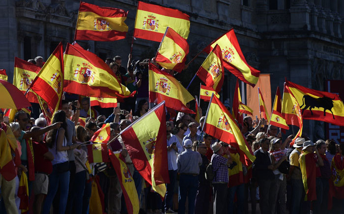 Protestors gather holding Spanish flags during a demonstration against independence of Catalonia called by DENAES foundation for the Spanish Nation Defence at Colon square in Madrid on 7 October 2017. Picture: AFP