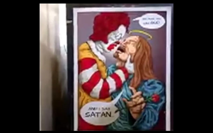 A screengrab of the artwork which displays Jesus with a clown. Picture: SABC Digital News/youtube.com