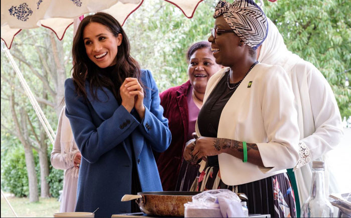 The Duke and Duchess of Sussex and Ms Doria Ragland are celebrating the launch of 'Together: Our Community Cookbook' with the women of the Hubb Community Kitchen. Picture: @Kensingtonroyal/Twitter