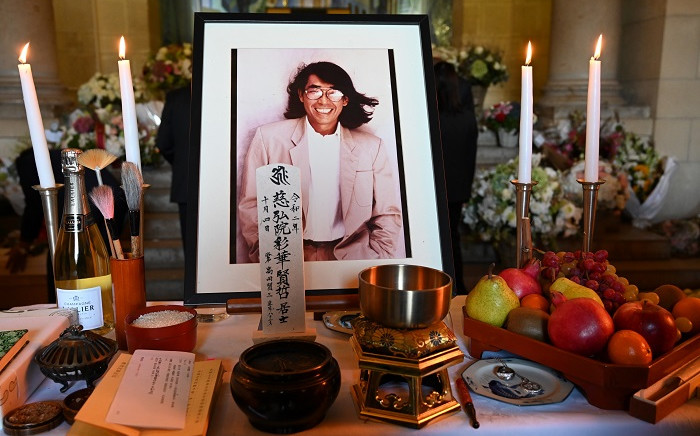 A portrait of late Japanese fashion designer Kenzo Takada and offerings are pictured on an altar at the end of a tribute ceremony on October 9, 2020 at the Pere Lachaise cemetary in Paris. Picture: AFP