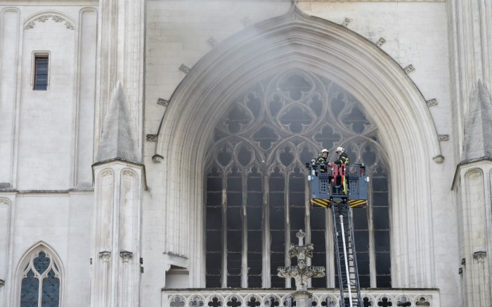 Firefighters are at work to put out a fire at the Saint-Pierre-et-Saint-Paul cathedral in Nantes, western France, on July 18, 2020. Picture: AFP