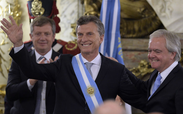 Argentine President Mauricio Macri, already wearing the presidential sash and staff, poses during his inauguration at the Casa Rosada government palace in Buenos Aires on December 10, 2015. Picture: AFP