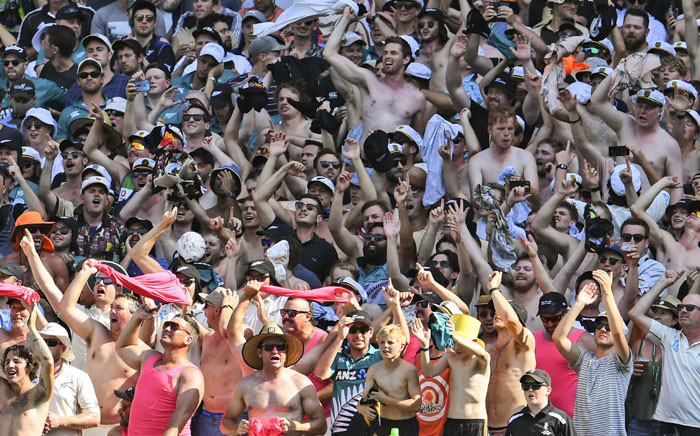 FILE: New Zealand fans cheer on their team as New Zealand loses to Australia on the fourth day of the second cricket Test match at the MCG in Melbourne on 29 December 2019. Picture: AFP.