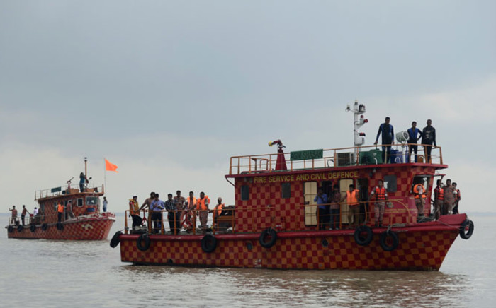 Bangladeshi rescue teams search the waters where an overloaded ferry capsized in the Padma river in Munshiganj, some 30 Km south of the capital Dhaka, on 6 August 2014. Picture: AFP.