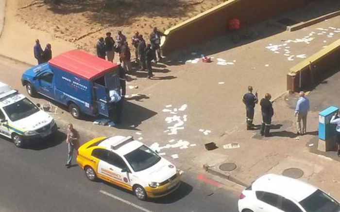 Police and emergency vehicles park outside the Post Office building in Randburg after protests on 2 September 2014. Picture: iWitness