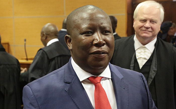 EFF leader Julius Malema jokes with the media ahead of his brief appearance in the Polokwane Magistrate's court on several charges including corruption and racketeering. Picture: Reinart Toerien/EWN.