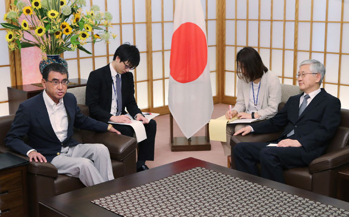 Japan's Foreign Minister Taro Kono (L) holds a meeting with South Korea's Ambassador to Japan Nam Gwan-Pyo (R) at his office in foreign ministry in Tokyo on 19 July 2019. Picture: AFP