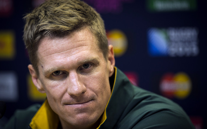 FILE: South Africa's centre and captain Jean de Villiers sustained jaw fracture during the Pool B match against Samoa in Birmingham on Saturday. Picture: AFP.