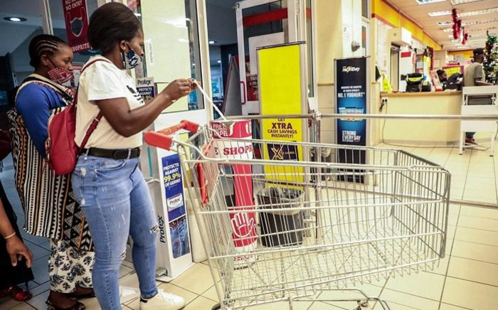 Customers have started trickling into Shoprite Diepsloot for their Black Friday discounted deals. There are no queues as compared to 2019. Picture: Abigail Javier/EWN