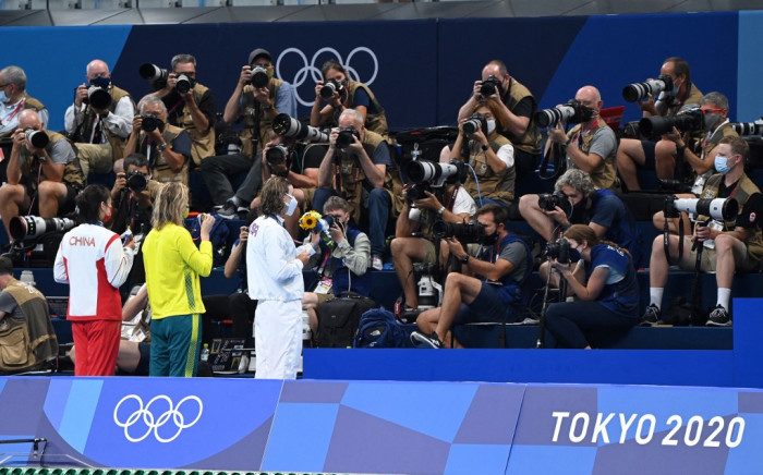Bronze medallist China's Li Bingjie (L), gold medallist Australia's Ariarne Titmus (C) and silver medallist USA's Kathleen Ledecky pose with their medals for photographers after the final of the women's 400m freestyle swimming event during the Tokyo 2020 Olympic Games at the Tokyo Aquatics Centre in Tokyo on 26 July 2021. Picture: AFP