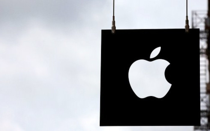 The Apple logo hangs in front of an Apple store on July 23, 2013 in New York City. Picture: AFP