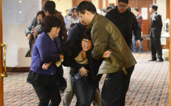 FILE: Grieving relatives of passengers on Malaysia Airlines flight MH370. Picture: AFP.