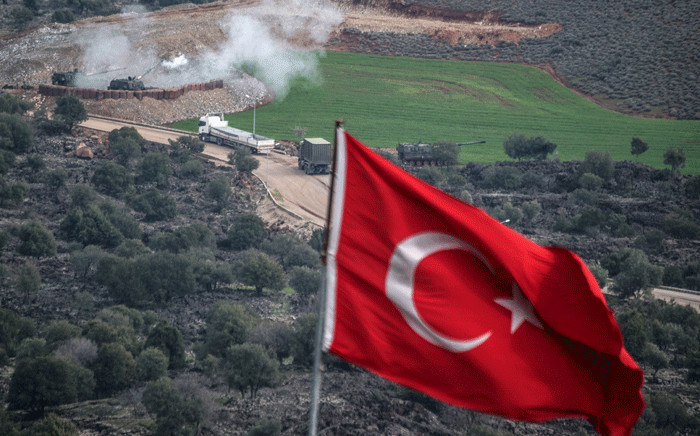 Turkish artillerys shell the People's Protection Units (YPG) positions near the Syrian border on 21 January 2018 near Hassa, as Turk's ground troops entered Syria to push an offensive against Kurdish militia. Picture: AFP.