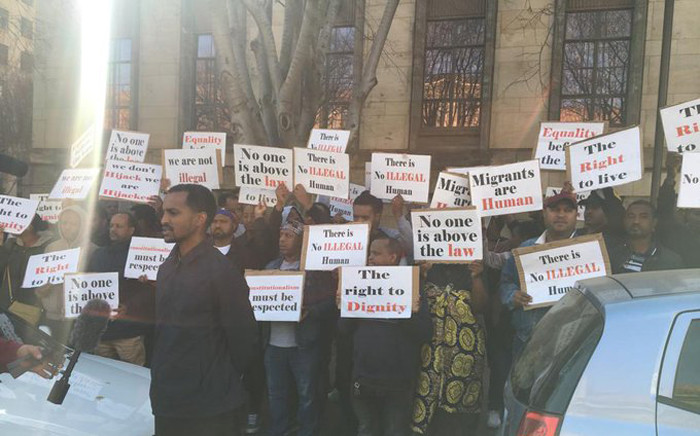 A group of foreign nationals protest outside the Johannesburg Magistrate Court on 12 August 2019. Picture: Edwin Ntshidi/EWN
