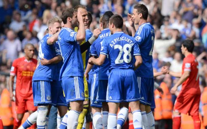 Chelsea players celebrate winning 2-0 at the end of the English Premier League football match between Liverpool and Chelsea at Anfield Stadium in Liverpool, northwest England, on April 27, 2014. Picture: AFP.