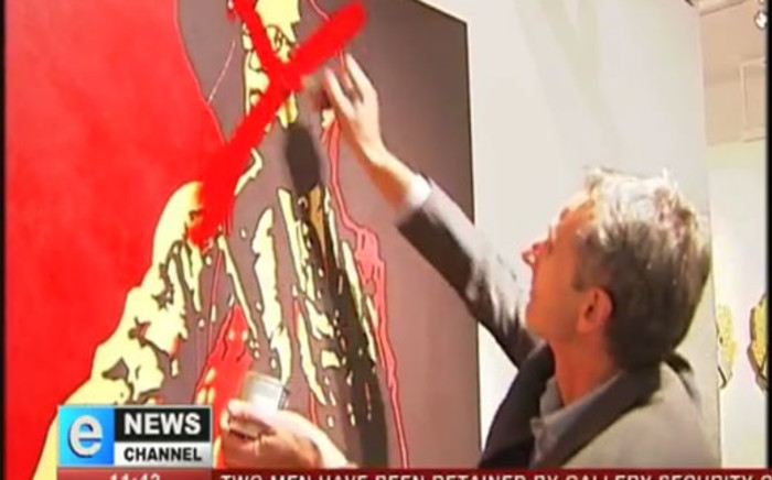 A man defaces 'The Spear' at the Goodman Gallery in Rosebank. Picture: eNews