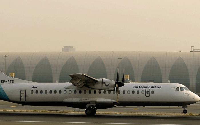 In this file photo taken on 29 July, 2008 a French-made ATR-72 owned by Iran's Aseman Airlines sits on the tarmac at Dubai airport. Picture: AFP