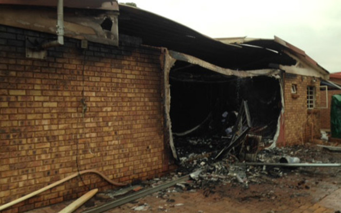 Angry residents in Guguglethu informal settlement torched and damaged the offices of the Community Policing Forum in the East Rand. Picture: Vumani Mkhize/EWN.