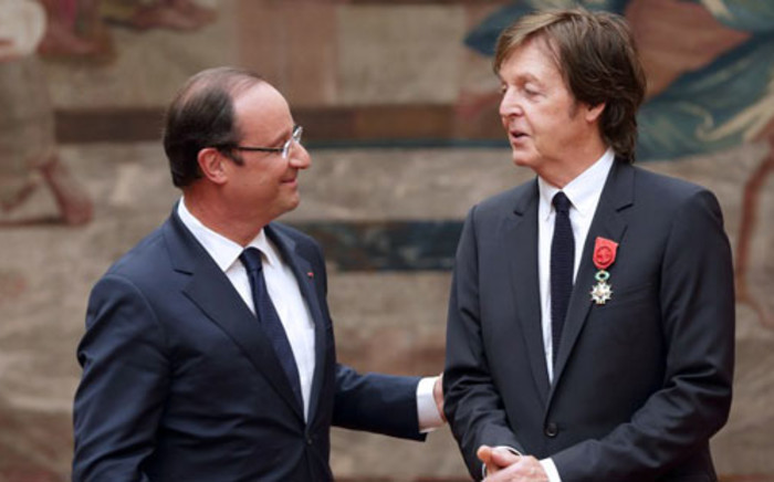 France's president Francois Hollande (L) speaks with former Beatles' singer Sir Paul McCartney after awarding him officer of the Legion of honour, the French hightest award on 8 September, 2012 at the Elysee Presidential Palace in Paris. Picture: AFP.