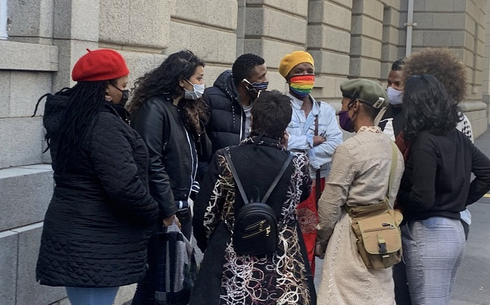 The group of activists who occupied a Camps Bay mansion to highlight land and housing issues stand outside the Western Cape High Court on 2 October 2020. Picture: Kaylynn Palm/EWN