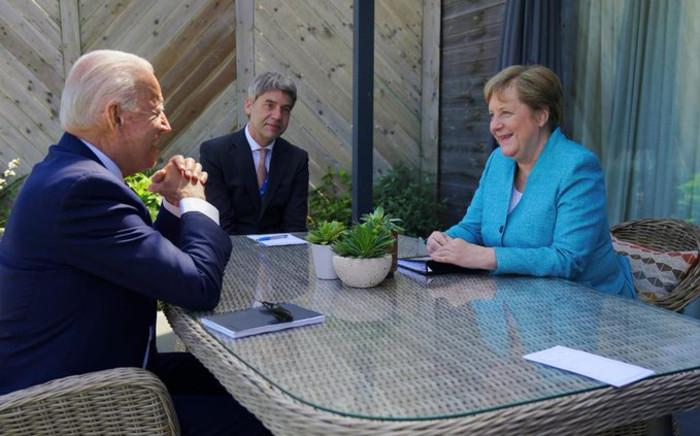 US President Joe Biden with German Chancellor Angela Merkel at the G7 Summit in Cornwall, England in June 2021. Picture: Twitter/@POTUS