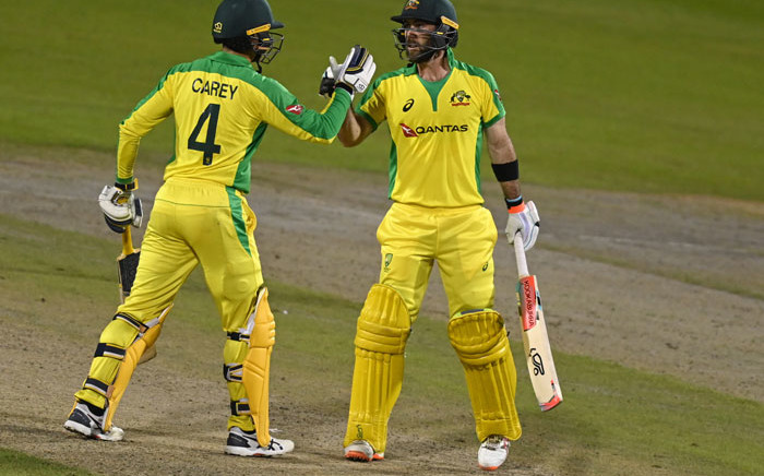 Australia's Glenn Maxwell congratulates teammate Alex Carey after he scored a century during the one-day international (ODI) cricket match between England and Australia at Old Trafford in Manchester on 16 September 2020. Picture: AFP