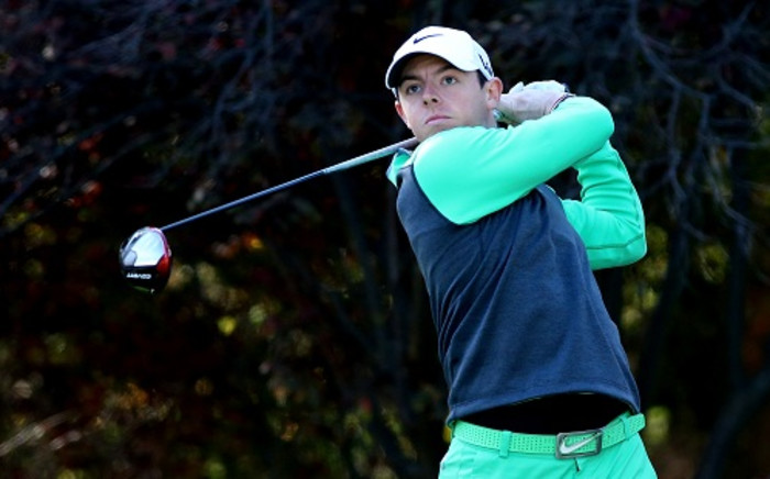 Rory McIlroy began the day six shots clear and increased his lead to seven strokes with a birdie at the first. Picture: AFP.