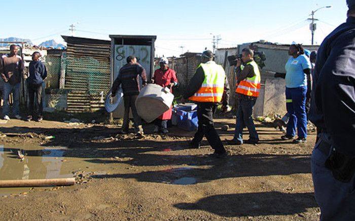 City of Cape Town workers clean portable toilets in Gugulethu on 11 June 2013. Picture: Tammy Abrahams/EWN