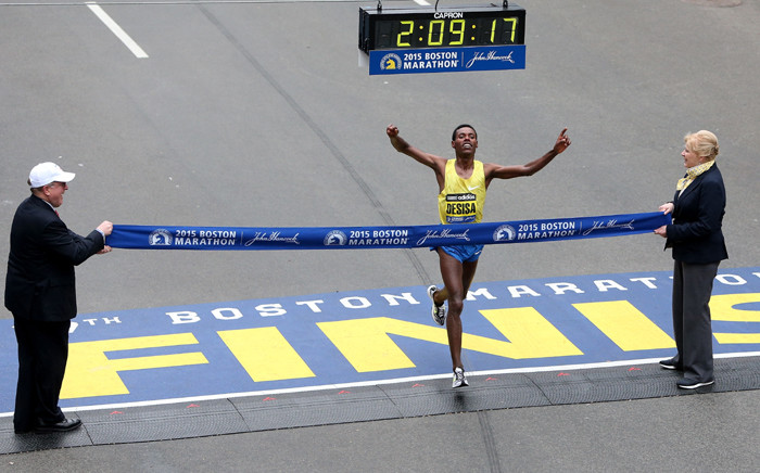Lelisa Desisa of Ethiopa crosses the finish line to win the 119th Boston Marathon on 20 April, 2015 in Boston, Massachusetts. Picture: AFP.
