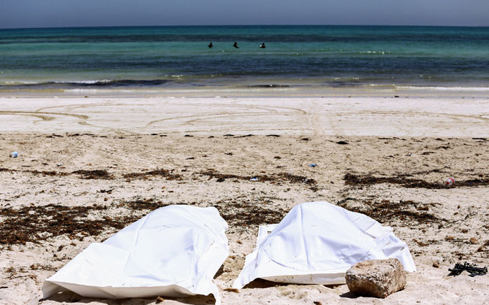This file photo picture taken on 6 July 2019 on the beach of Aghir in Tunisia's southern island of Djerba shows recovered bodies from a boat carrying 86 migrants that capsized off the Tunisian coast while crossing the Mediterranean from Libya to Italy. Picture: AFP