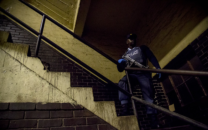 FILE. Police seized drugs and stolen goods during their overnight raids at the Jeppestown hostels on 21 April 2015. Picture: Thomas Holder/EWN.