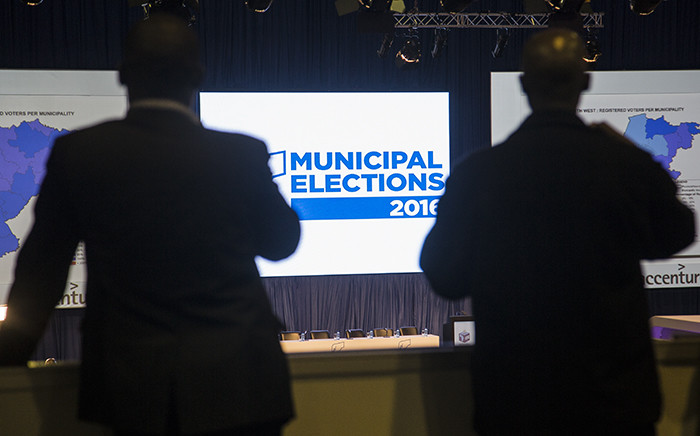 Two men stand overlooking the main floor at the IEC National Results Centre on 3 August 2016. Picture: Reinart Toerien/EWN.